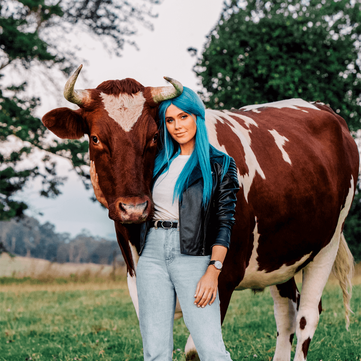 Dara Hayes, AKA DJ Tigerlily, with rescue cow (image by Noah Hannibal)